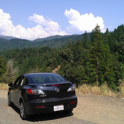 Car parked off the Redwood Highway in California. Overlooking a hidden valley inhabited by honeybees and pine.